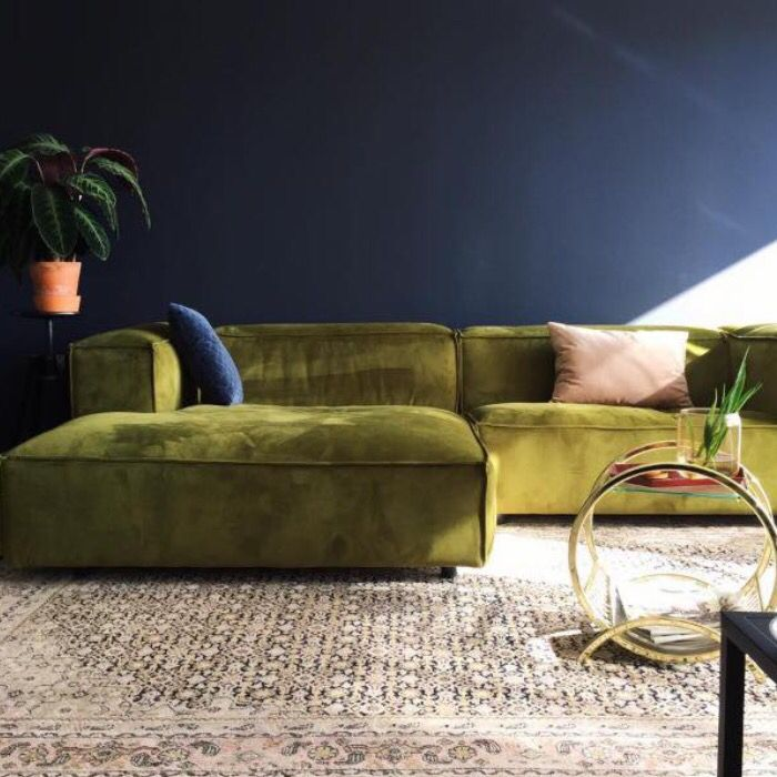 green sofa colors and patterned rug VXQBFMT