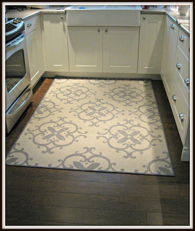 kitchen rug outdoor rug in kitchen (walmart)- great idea! warm under feet but washable AEWGFNS