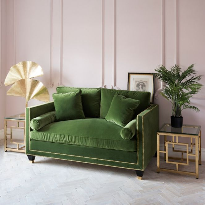 leafy green sofa with blush sugary pastel pink walls. painted panelling.  tropical BIGQSPH