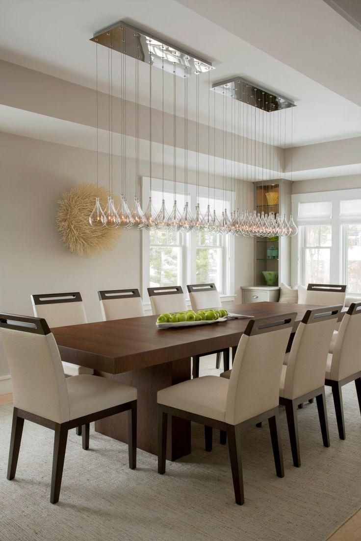 modern dining table this modern dining room space features a long glass chandelier hung over a BJZCXKP