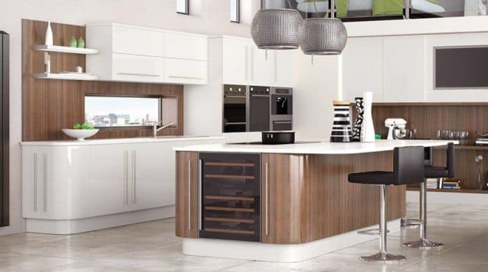 modern fitted kitchen with white cabinets and an island with wine storage CPJJHUW
