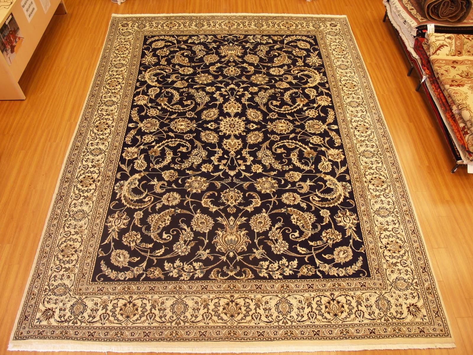 modern living room decoration using floral accent carpet designs on  laminate wood MARJVJX