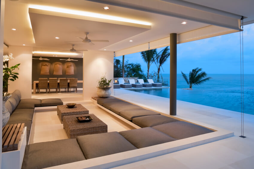 modern living rooms modern living room with huge sectional sofa and floor-to-ceiling picture  windows. CUIUDFB