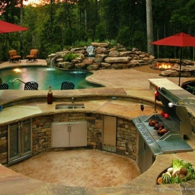 rustic patio with rough cut stone veneer, raised beds, outdoor kitchen,  exterior XJGFPBO