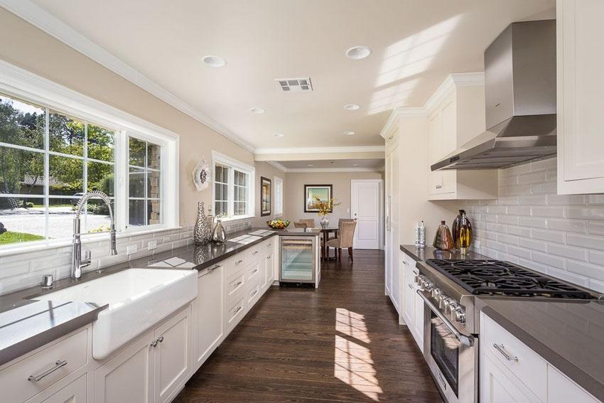 traditional galley kitchen with white cabinets backsplash WAYUHXF