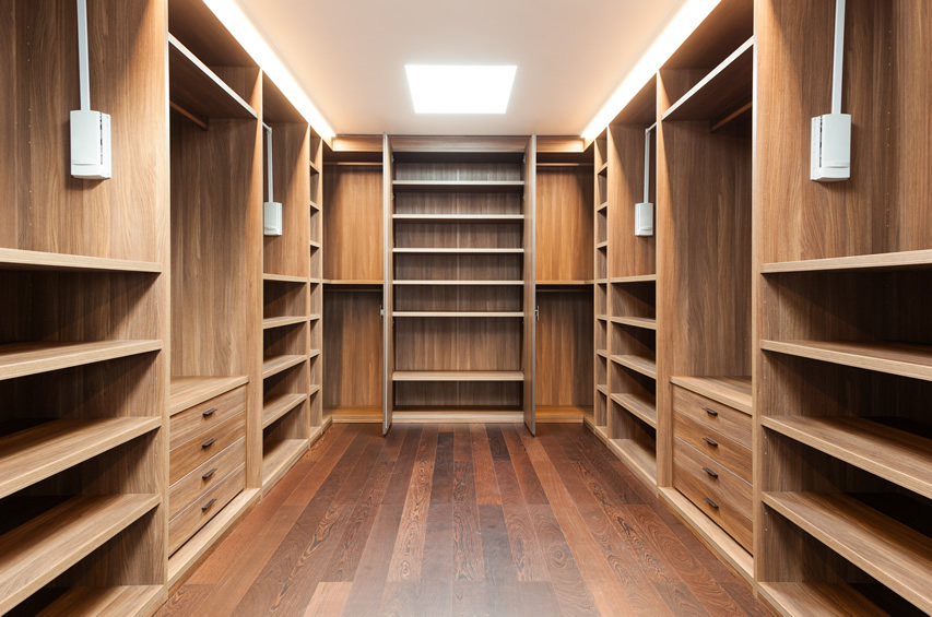 walk in closets walk in closet with wood flooring ABIIBGW