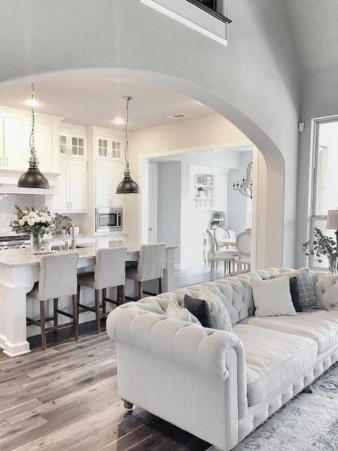 white living room neutral farmhouse kitchen with dark hardwood floors. farmhouse kitchen with  open layout. WJLGXUA