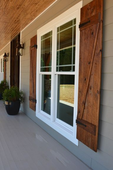 wood shutters front porch with custom ceiling, cedar posts, stone columns and wood  shutters. RNKIQNZ