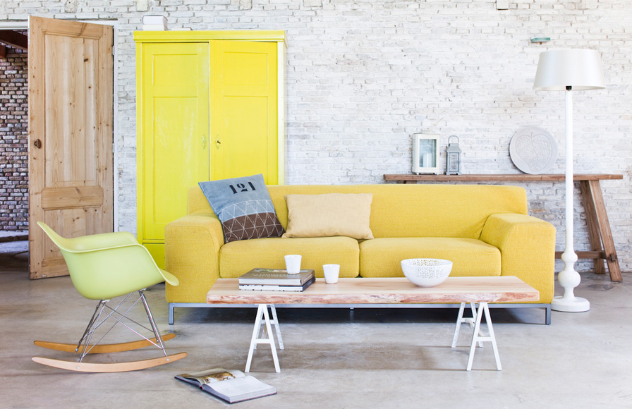 yellow sofa white washed bricks wall and yellow pale sofa SAFFYTU