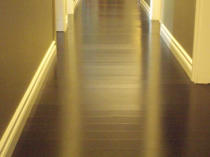 best flooring options hallway with engineered hardwood flooring in black LUXRHQF