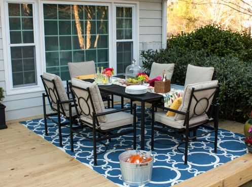 outdoor rug under patio table these very practical small patio decorating ideas are by kelly of view CIIGBFJ