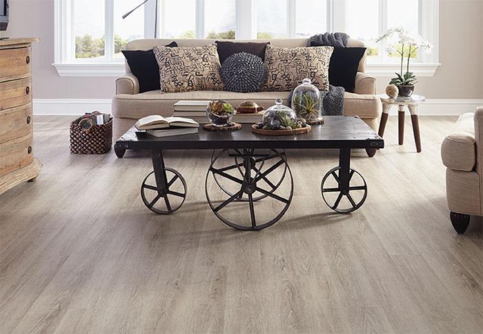 vinyl wood flooring light planks of wood-look vinyl flooring in a living room. MEKTETK
