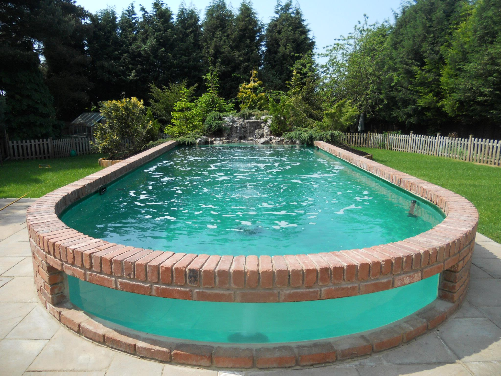 above ground pools that look like in ground above ground pools can come with waterfall features. image source ... RESQXWH