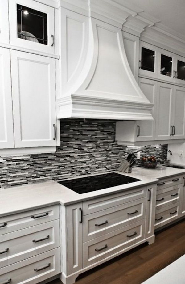 black and white kitchen backsplash ideas black or grey linear glass tile backsplash with crisp white cabinetry DTMGXTY