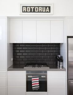 black and white kitchens with a splash of colour #kitchengoals black and white. black subway tile backsplash with black JHBKXRV