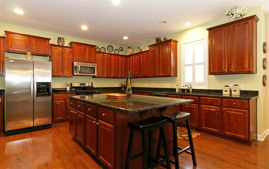 cherry kitchen cabinets with granite countertops of LVQUVWL