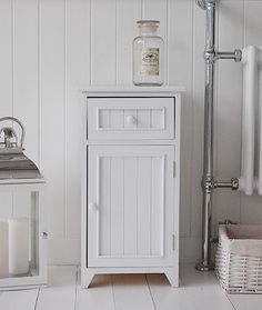 free standing bathroom cabinets with drawers a crisp white freestanding bathroom storage furniture. a narrow bathroom JKRMFIB