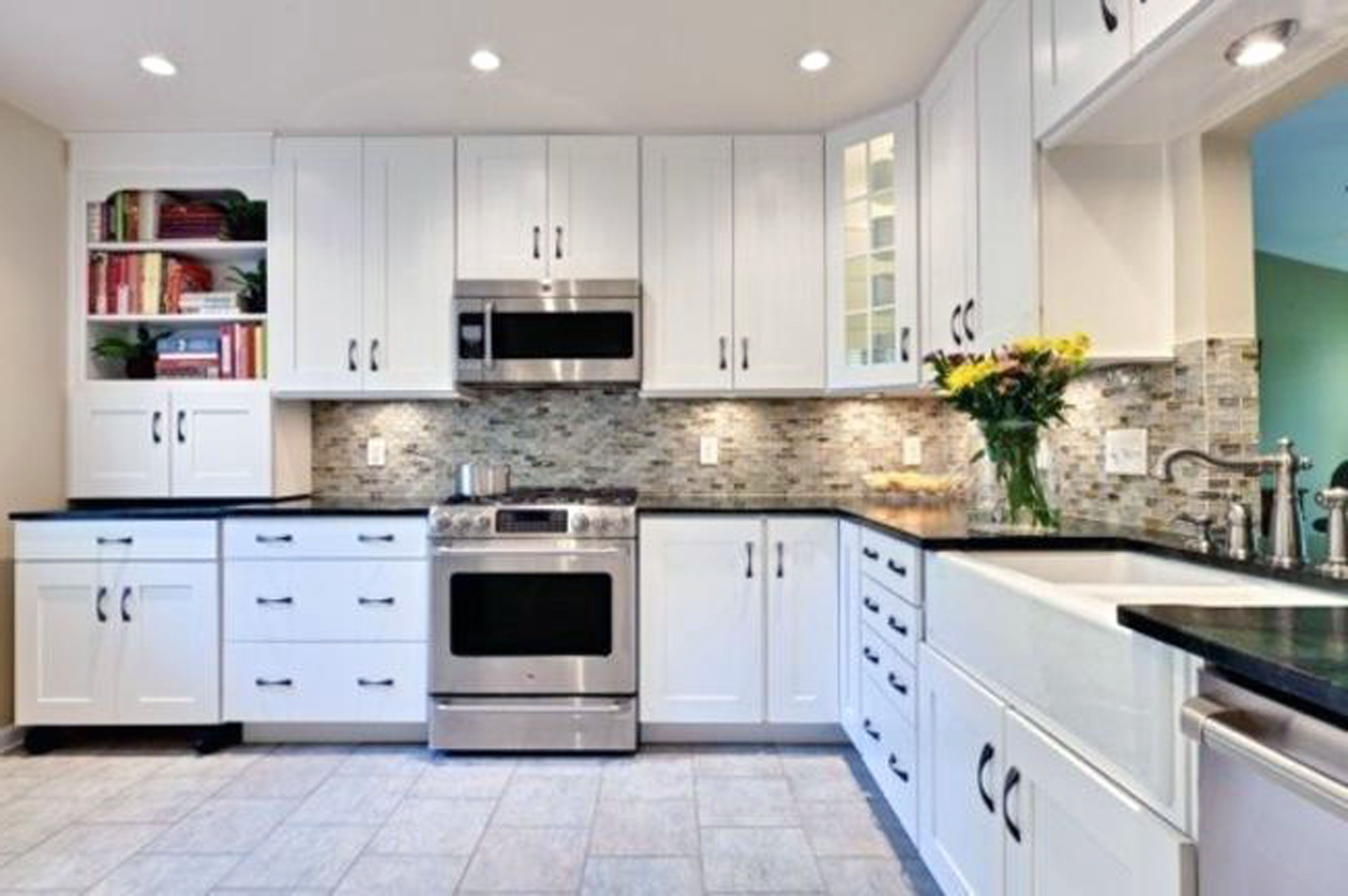 kitchen with white cabinets and black countertops ... bookcase a perfect backsplash ideas for white cabinets and XRGCIUU
