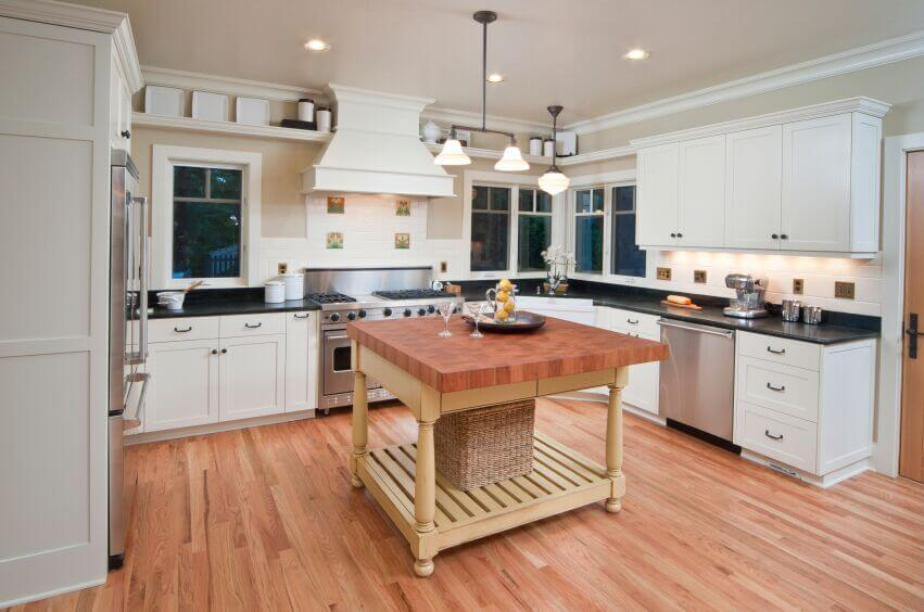 kitchen with white cabinets and black countertops the dark counters in this kitchen break up the white WZFOBMA