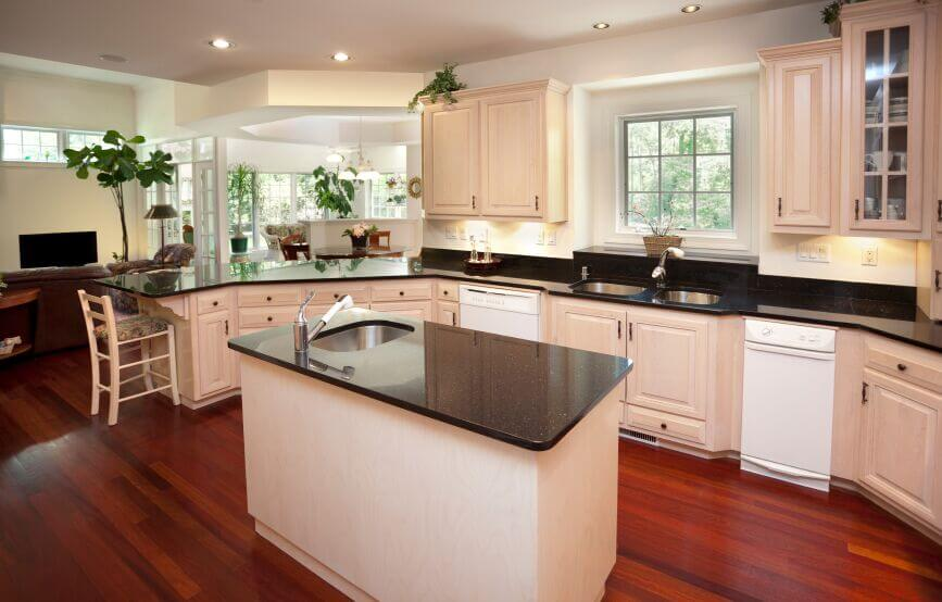 kitchen with white cabinets and black countertops this lovely kitchen continues the bright, open feel apparent in IVETCVE