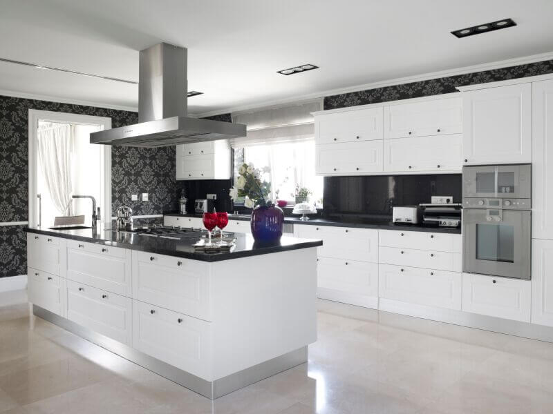Kitchen With White Cabinets And Black Countertops: How to Work With It