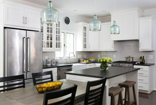 kitchen with white cabinets and black countertops traditional kitchen by winn design+build VSHLLYZ