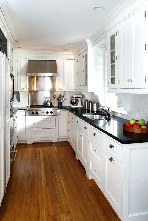 kitchen with white cabinets and black countertops white kitchen cabinets with black countertops white cabinets white XBSXIQF