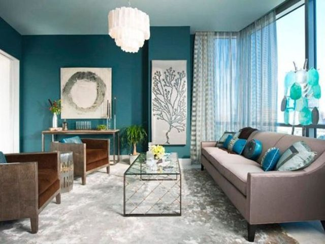 living room accent wall with brown furniture a teal accent wall, aqua blue accessories and brown upholstered BMNYUOV