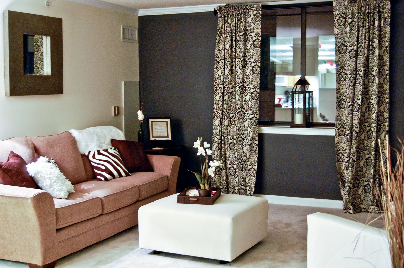 living room accent wall with brown furniture brown walls living room decor FLCXCPV