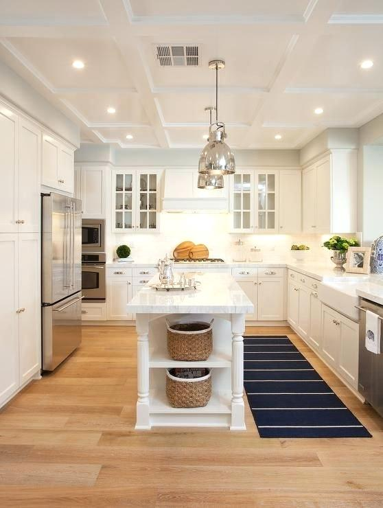 long narrow kitchen island with seating decoration: a pair of polished nickel industrial pendants hang over KELMTSH