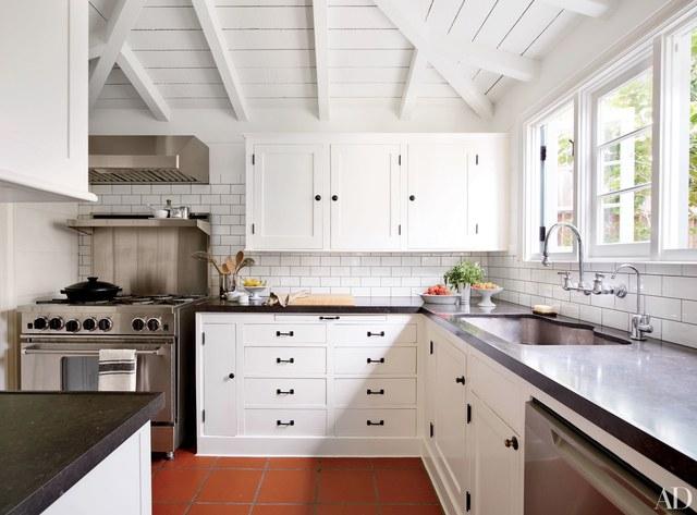 white kitchen cabinets with black countertops 25 black countertops to inspire your kitchen renovation OBSNPLQ