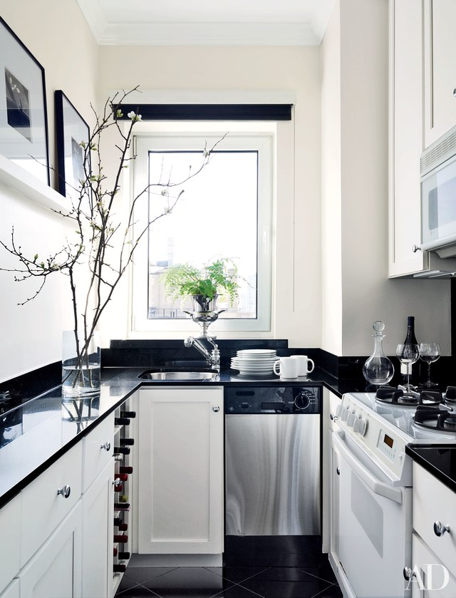 white kitchen cabinets with black countertops 25 black countertops to inspire your kitchen renovation PGVFFDS