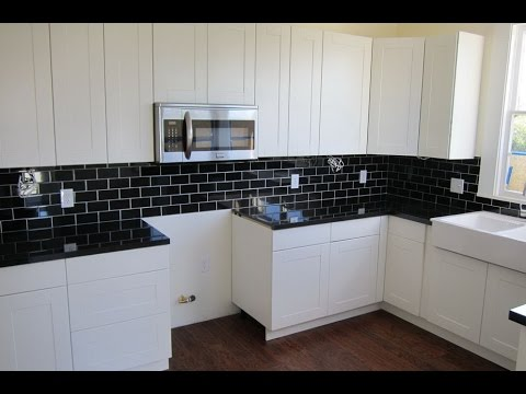 white kitchen cabinets with black countertops backsplash ideas for black granite countertops and white cabinets JAIZEWJ