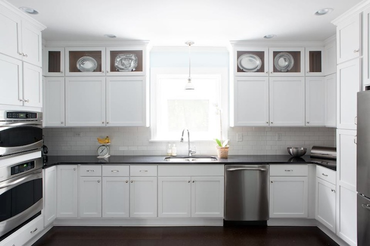 white kitchen cabinets with black countertops LHWZTZV