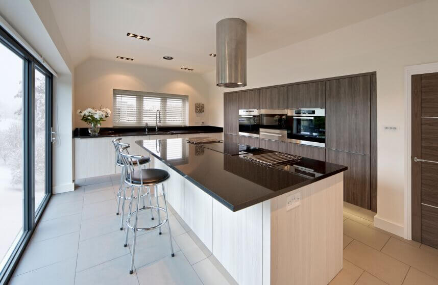 white kitchen cabinets with black countertops this minimalist kitchen is a lovely balance of light and EKZYHKR
