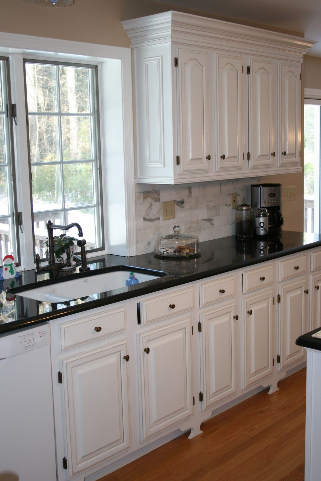 white kitchen cabinets with black countertops white cabinets black countertops and that faucet ZDHVCSE