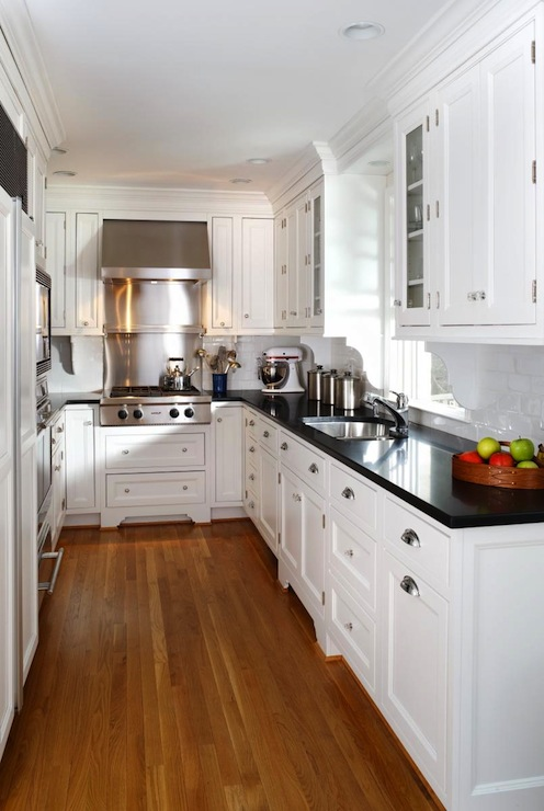 white kitchen cabinets with black countertops YRSPRRR