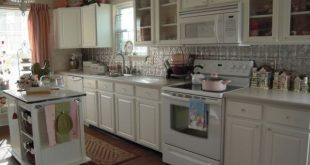 white kitchen cabinets with white appliances cottage charm. view in gallery. white cupboards ... OSKQZTX