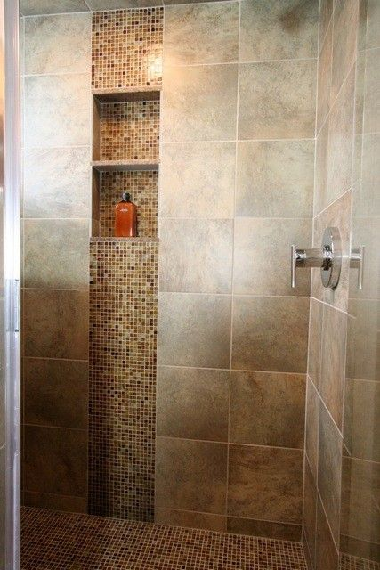 I like when they use accent tile in the vertical. shower ideas
