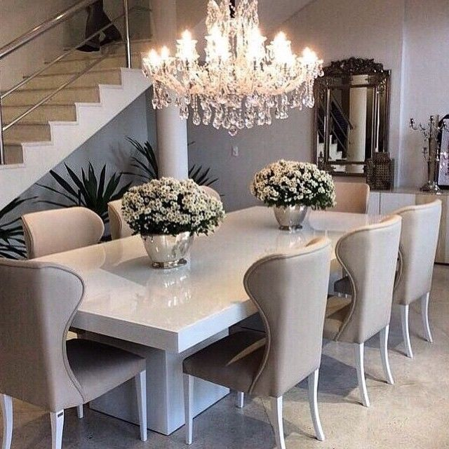 Sleek white table with ivory/beige dining chairs, top off the