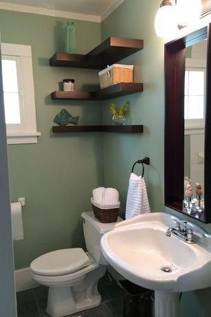 Traditional Powder Room with Wicker baskets, stone tile floors .