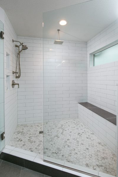 Beautiful shower with hexagonal tile, white 4 x 16 white subway .
