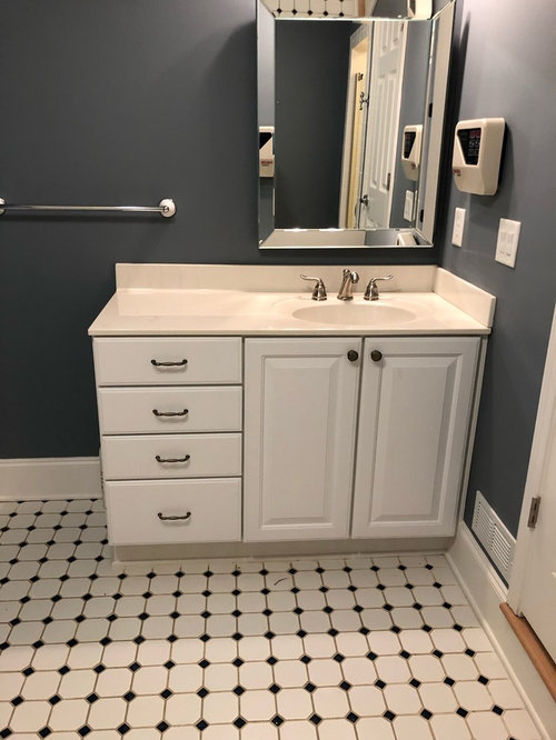 Black/White floor tile but gray counter. Wall color