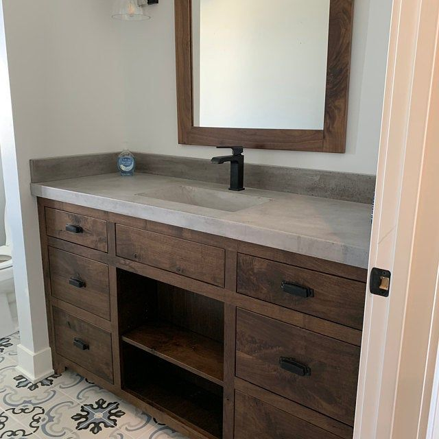 Concrete bathroom vanity top with integral sink and backsplash .