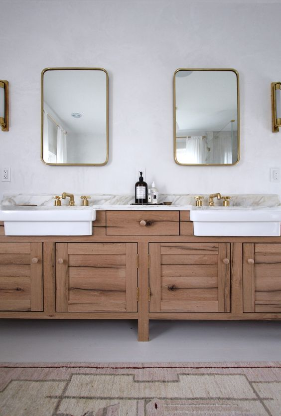 apron front sinks in the bathroom: one trend, two ways — dlgh