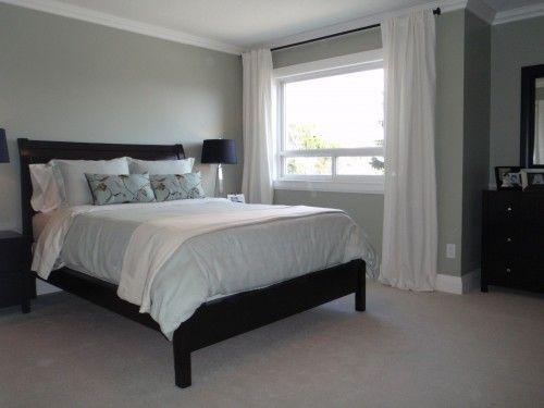 Grey Walls, white curtains, dark furniture- looks like everything .