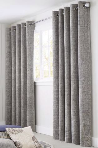 These grey curtains are thick, perfect for blocking the sun out .