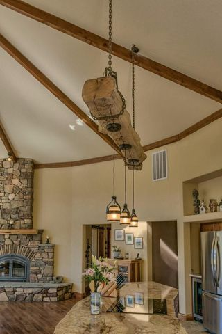 rustic reclaimed wood beam over kitchen island with hanging .