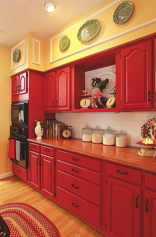 Rich red hues on cabinets and reddish brown countertops give your .