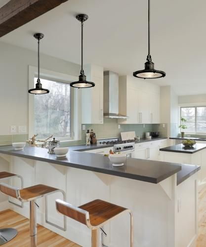 Industrial pendant lights accent a transitional kitchen picture .